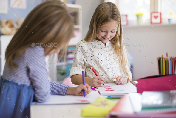 Two cute girls playing together - Stock Photo - Images