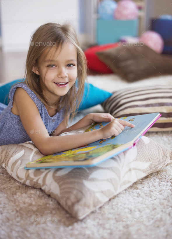 The most favourite book of little girl - Stock Photo - Images