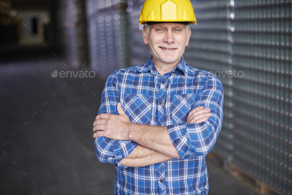 Portrait of manual worker at the warehouse - Stock Photo - Images