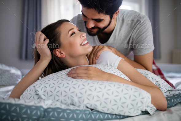 Cheerful young couple making massage at home - Stock Photo - Images