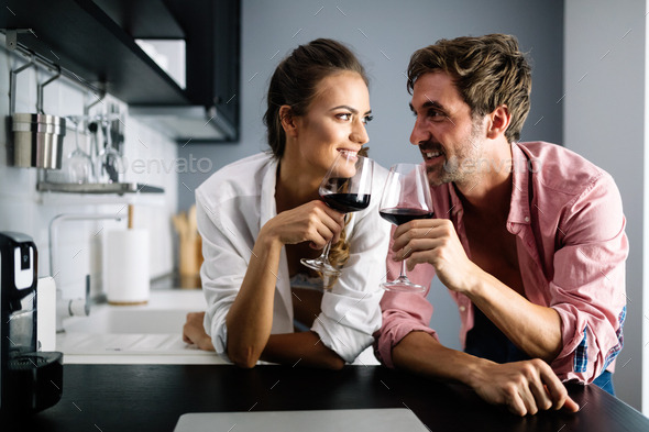 Young couple relaxing at home with laptop. Love,happiness,people and fun concept - Stock Photo - Images