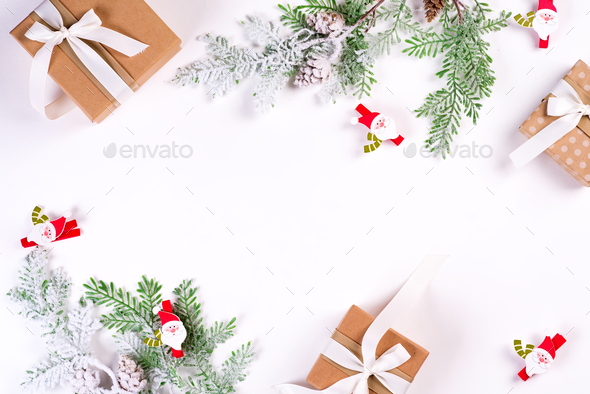 Christmas and New Year holiday composition. Mock up frame with fir branches, gift box, ribbons and - Stock Photo - Images