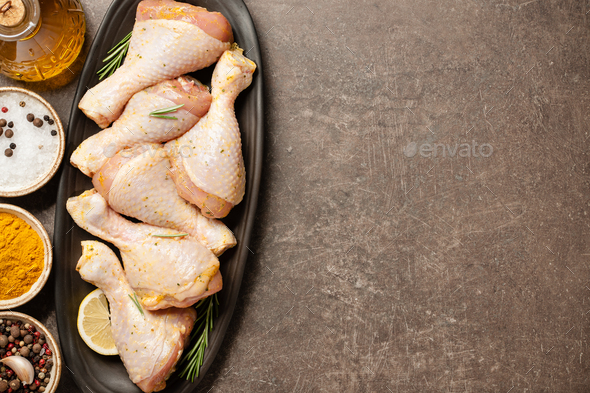 Fresh marinated chicken legs for cooking - Stock Photo - Images