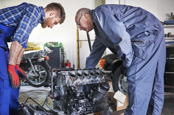Trying to repair car's engine - Stock Photo - Images