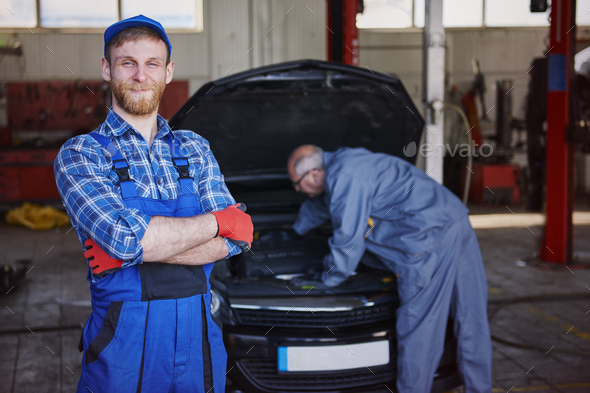 An experienced, friendly and efficient mechanic of cars - Stock Photo - Images