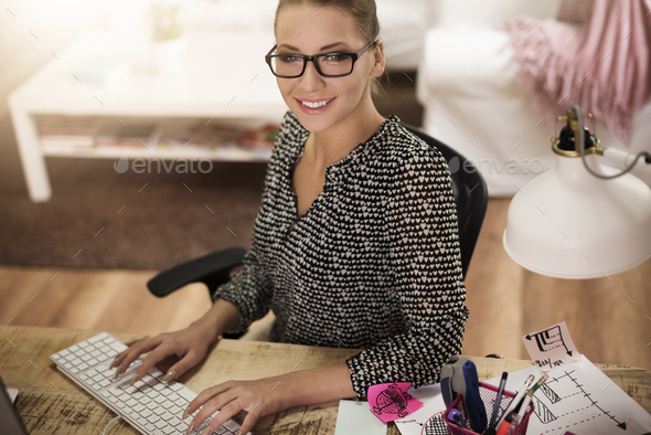 Young woman working at home in the office - Stock Photo - Images