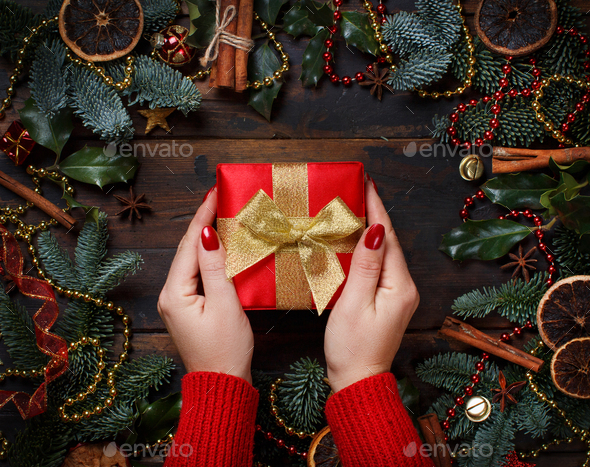 Christmas composition with hands keeping gift box - Stock Photo - Images