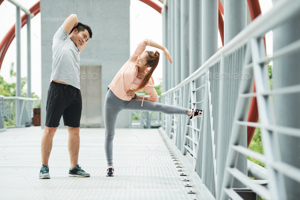 Exercising young couple. - Stock Photo - Images