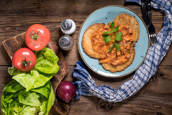 Homemade potato pancakes with goulash. - Stock Photo - Images