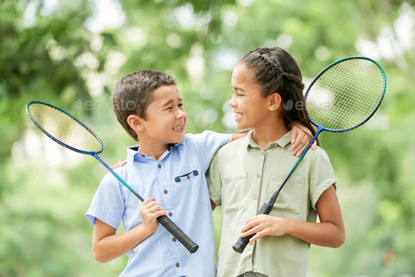 Cheerful siblings after badminton game - Stock Photo - Images