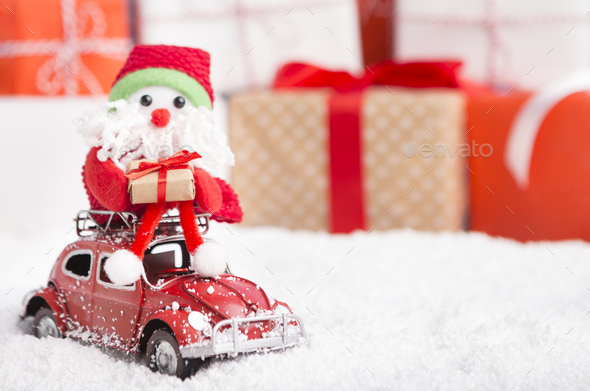 New year Santa delivering presents by car on background - Stock Photo - Images