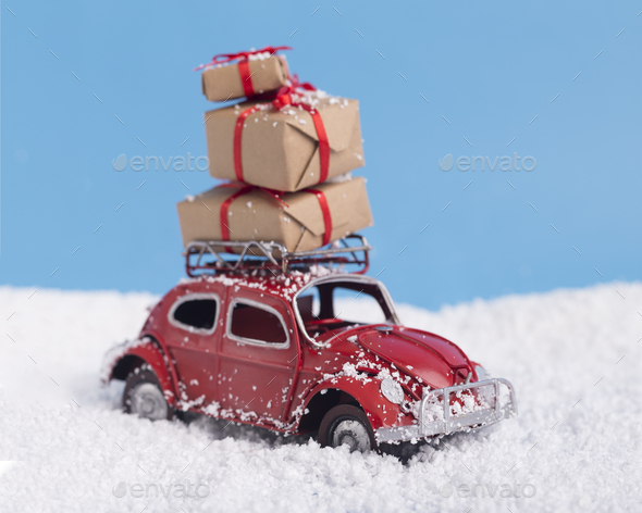 Close up of retro red car with Christmas and New Year presents - Stock Photo - Images