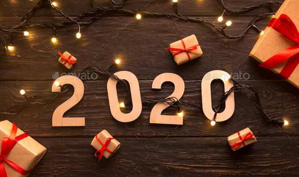 New year concept with present boxes and wooden 2020 - Stock Photo - Images