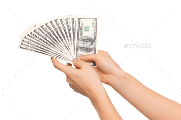 Successful investment. Fan of dollar banknotes in female hands - Stock Photo - Images