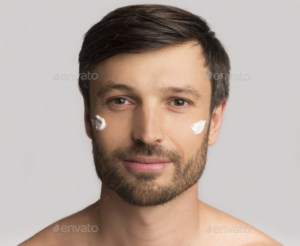Mature Man Applying Face Cream On Skin, White Background - Stock Photo - Images