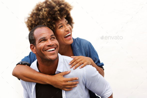 smiling couple standing in embrace on white background - Stock Photo - Images
