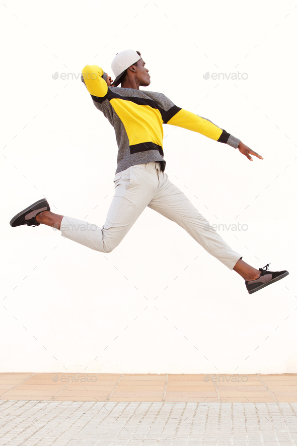 cool young african man jumping in air - Stock Photo - Images