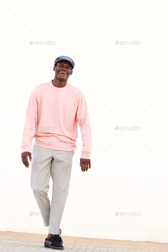stylish young african male model standing against white wall - Stock Photo - Images