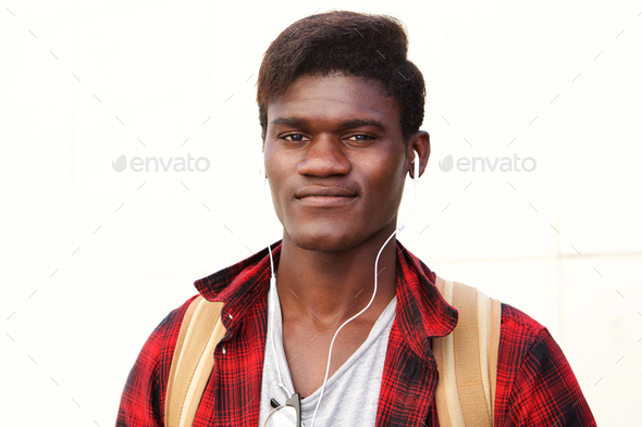 Close up handsome young black man standing against white background - Stock Photo - Images