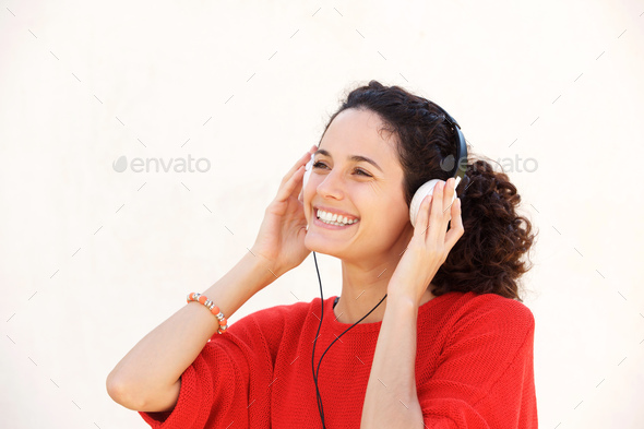 Close up beautiful young woman listening to music with headphone - Stock Photo - Images