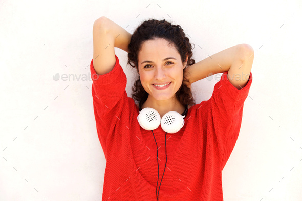 Close up attractive  young woman with headphones and hands behin - Stock Photo - Images
