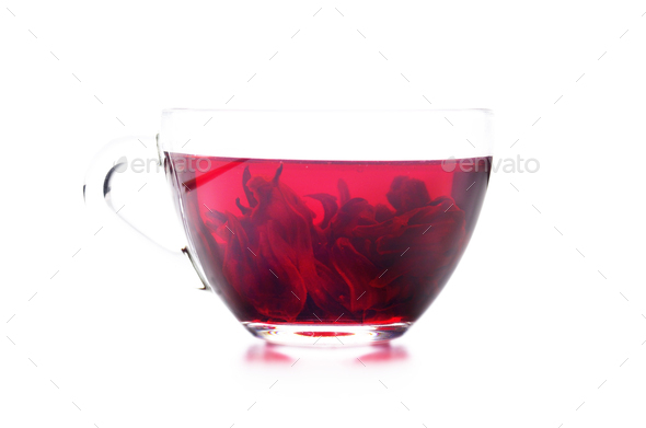 Hibiscus Tea cup with petals inside isolated on white background - Stock Photo - Images
