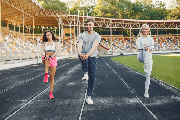 Sports people training at the stadium - Stock Photo - Images