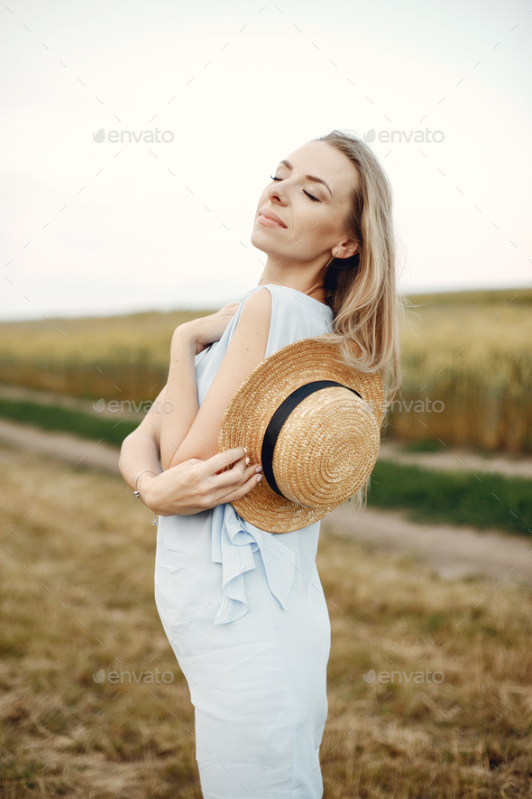 Elegant and stylish girl in a autumn field - Stock Photo - Images