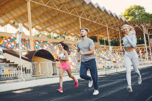 Sports people training at the stadium - Stock Photo - Images