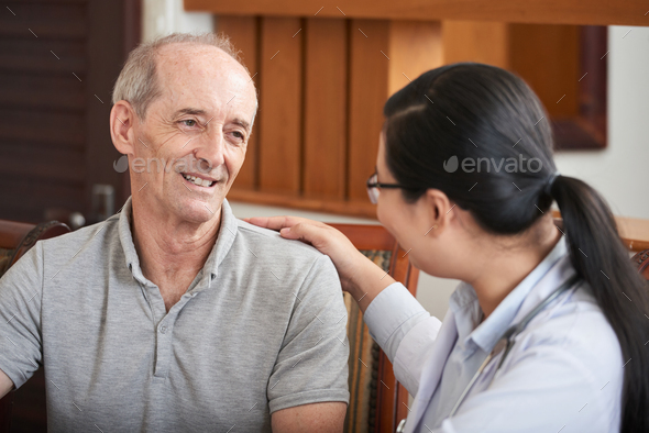 Careful doctor with senior man - Stock Photo - Images