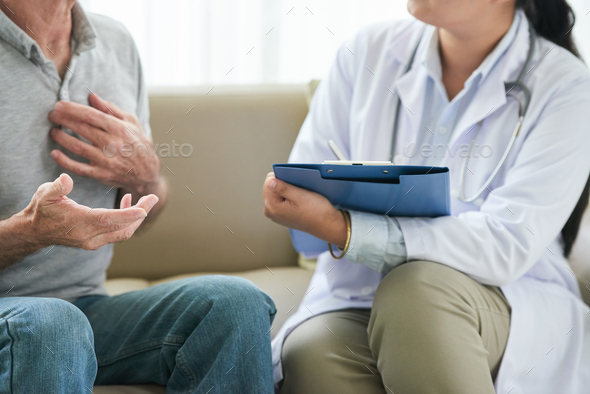 Crop doctor taking notes after patient - Stock Photo - Images