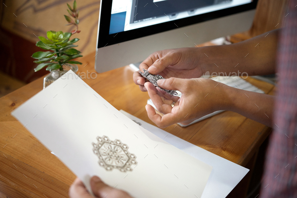 Master showing tattoo sketch - Stock Photo - Images