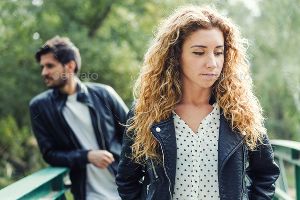 Young couple being in a conflict in the park. - Stock Photo - Images