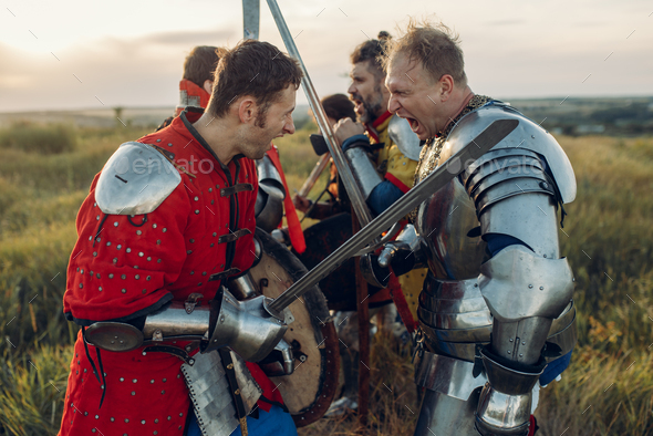 Medieval knights fight with sword and axe - Stock Photo - Images
