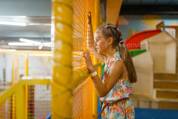 Adorable little girl playing in kids labyrinth - Stock Photo - Images