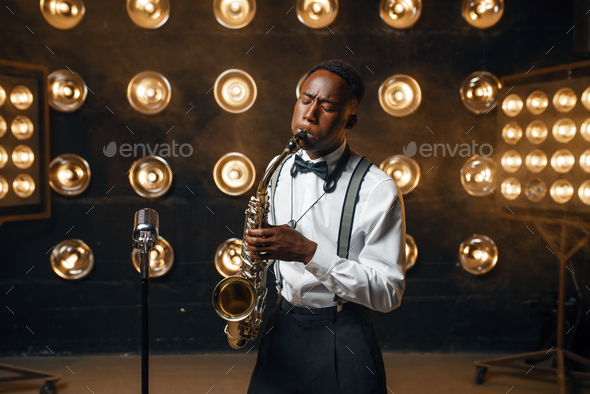 Black jazz performer plays the saxophone on stage - Stock Photo - Images