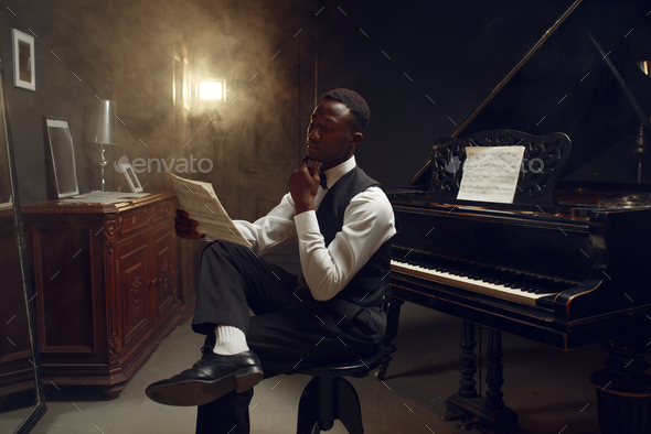 Stylish black grand piano player, jazz performance - Stock Photo - Images