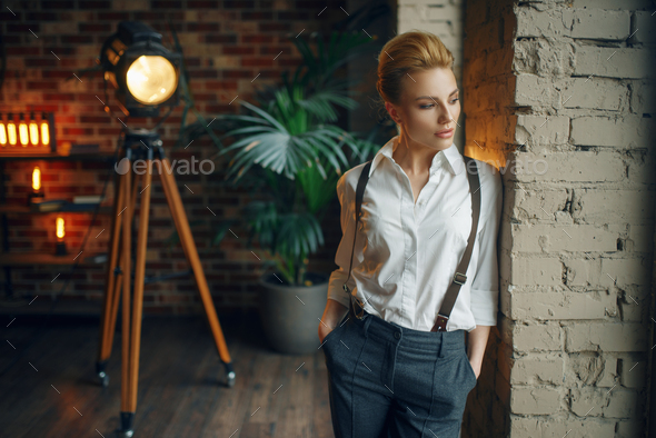 Business woman in strict clothes at the window - Stock Photo - Images