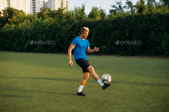 Male soccer player with ball standing on line - Stock Photo - Images