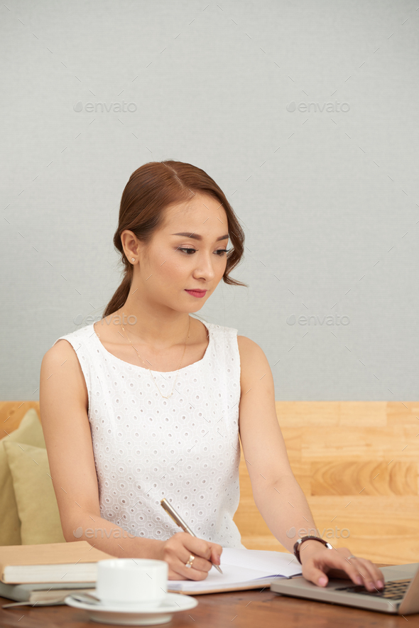 Young businesswoman busy with work - Stock Photo - Images