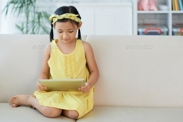 Girl with digital tablet - Stock Photo - Images