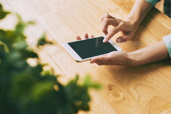 Checking text messages - Stock Photo - Images