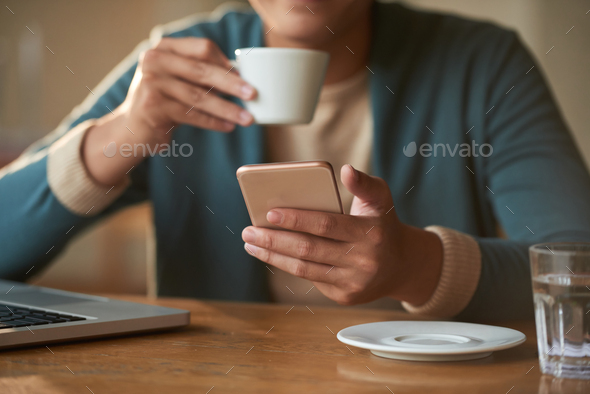 Man checking smartphone - Stock Photo - Images