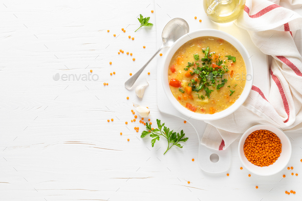 Vegetarian vegetable lentil soup with fresh parsley, healthy eating, top view - Stock Photo - Images