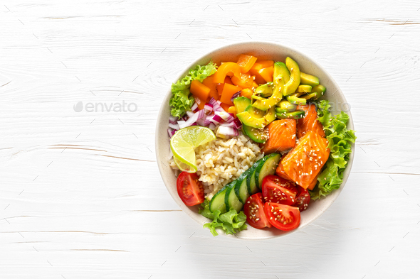 Buddha lunch bowl with grilled salmon fish, vegetables, lettuce salad and rice - Stock Photo - Images