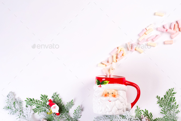 Cozy Christmas holiday concept. Christmas toys, green fir branches, Santa Claus cup with fluffy - Stock Photo - Images