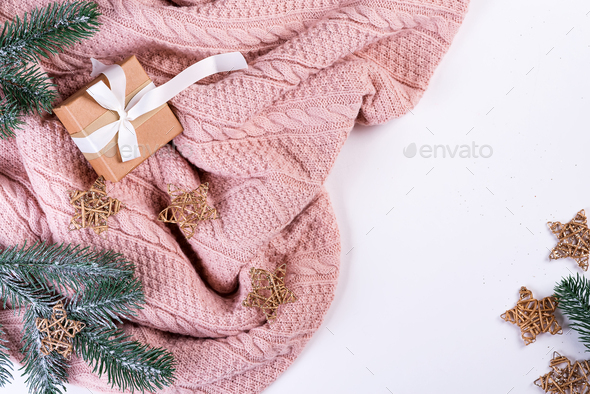Pink knitted sweater with gift box, christmas decoration and fir branches on a white background, top - Stock Photo - Images