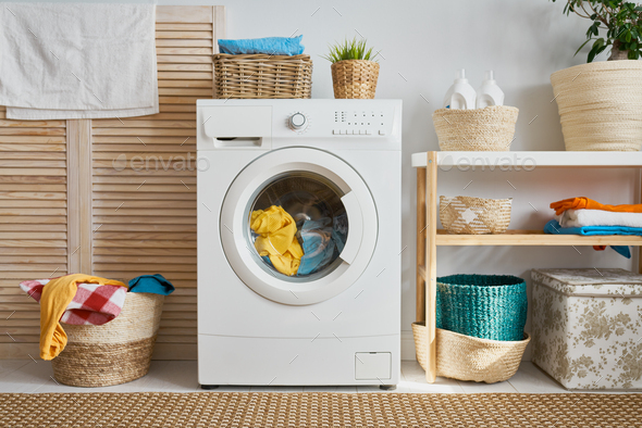 laundry room with a washing machine - Stock Photo - Images
