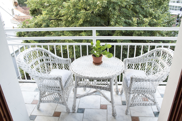 Terrace with Wicker Furniture and a View of the Treetop - Stock Photo - Images