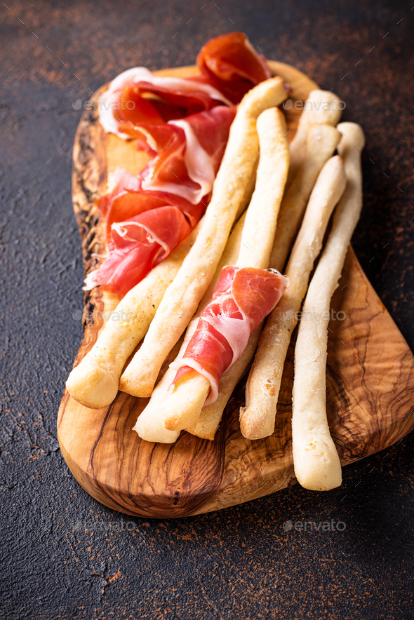 Traditional Italian antipasto grissini and prosciutto - Stock Photo - Images